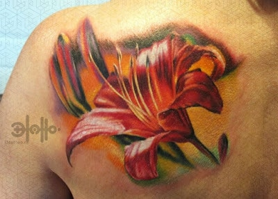 Stunning-Orange-lily-On-Waves-Tattoo