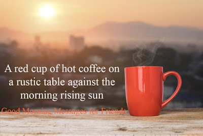 A red cup of hot coffee on a rustic table against the morning rising sun